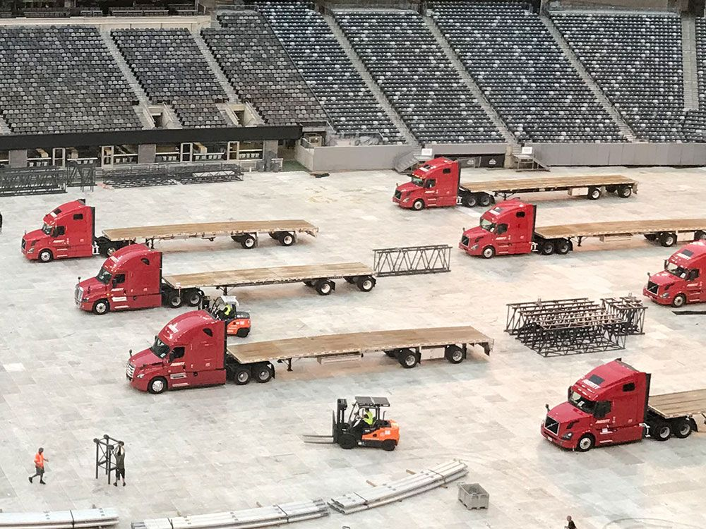 On Tour Logistics flatbed fleet delivering world's largest stage to Nashville Nissan Stadium for Ed Sheeran North America Tour in 2018.
